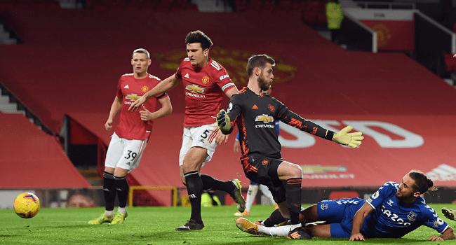 Everton's English striker Dominic Calvert-Lewin scores his team's third goal during the English Premier League football match between Manchester United and Everton at Old Trafford in Manchester, north west England, on February 6, 2021. Michael Regan / POOL / AFP