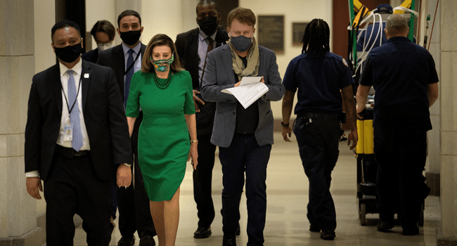 Speaker of the House Nancy Pelosi (D-CA) walks to a press conference about Covid-19 financial relief and minimum wage on Capitol Hill February 26, 2021, in Washington, DC. Brendan Smialowski / AFP
