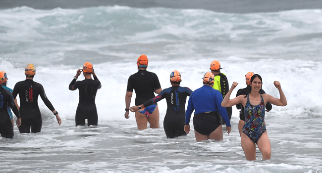 Residents enjoy big waves on the Bondi beach at the end of 106-days lockdown in Sydney on October 11, 2021, as a long coronavirus lockdown lifted in Australia's largest city. Saeed KHAN / AFP