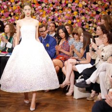 White couture Dior gown at show 2012 with Anna Wintour
