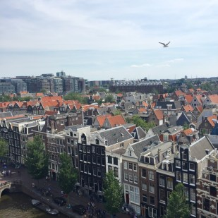 City view from above the Oude Kerk rooftop terrace by Taturo Atzu