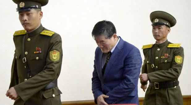 A man (C) who identified himself as Kim Dong Chul, previously said he was a naturalized American citizen and was arrested in North Korea in 2015.
