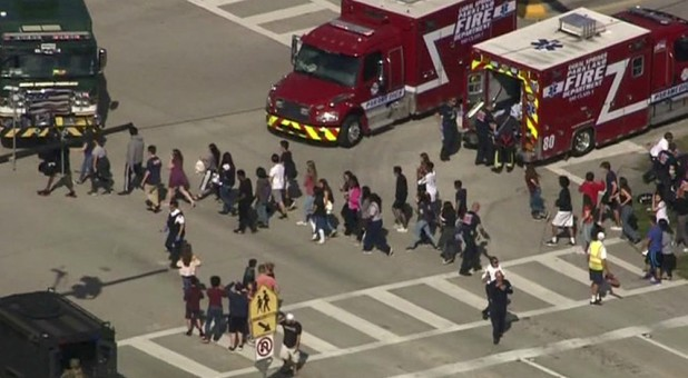 Students are evacuated from Marjory Stoneman Douglas High School during a shooting incident in Parkland, Florida, Feb. 14, 2018, in a still image from video.