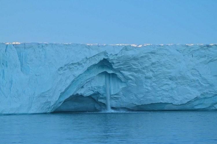 Stunning Glacier Waterfall in Svalbard Norway 1