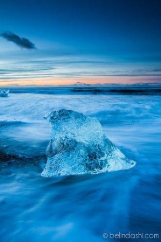 Iceberg in sunrise