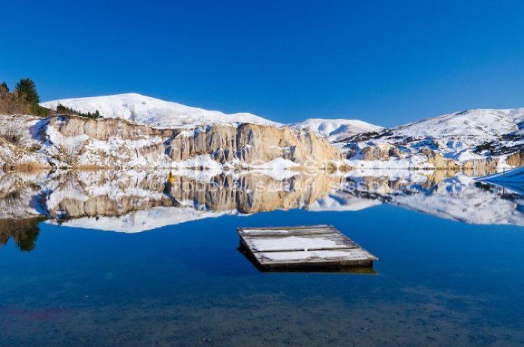 New Zealand Stock Photos | St Bathans, Blue Lake reflection & pontoon, Central Otago