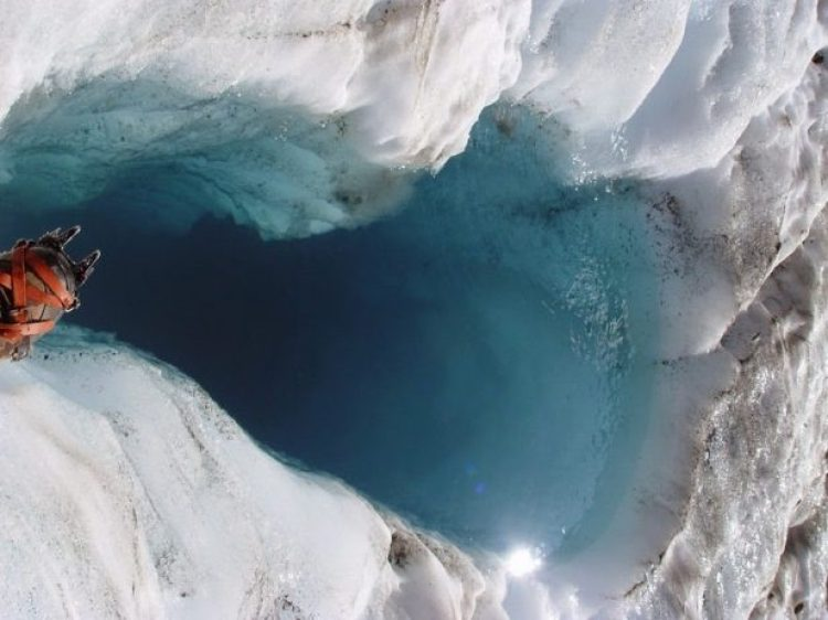 A moulin filled with water on Columbia Glacier.