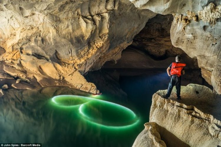 Water painting with kayaks and submerged LED lights near the downstream entrance of the cave 2