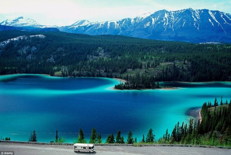 Be enchanted by the incredible blue Muncho Lake along Alaska Highway in British Columbia