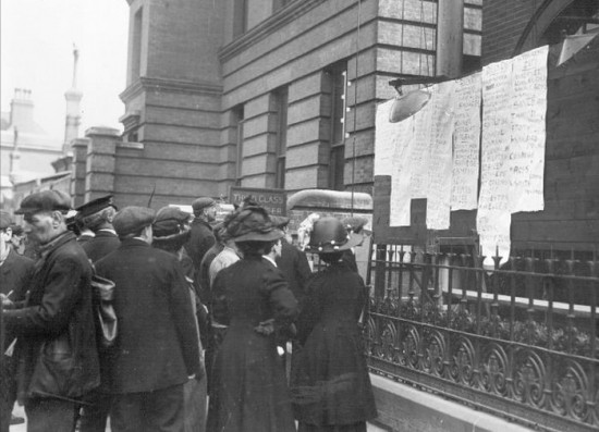 People in Southampton checking the Titanic survivor list posted outside the White Star Line office. April, 1912