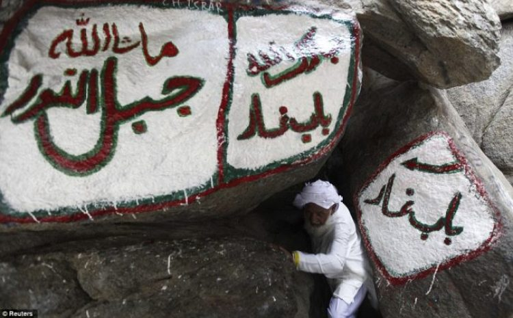 A Muslim pilgrim makes his way out of the Hira cave on Mount Noor. The hajj is one of the five pillars of Islam that every capable Muslim must perform at least once in lifetime