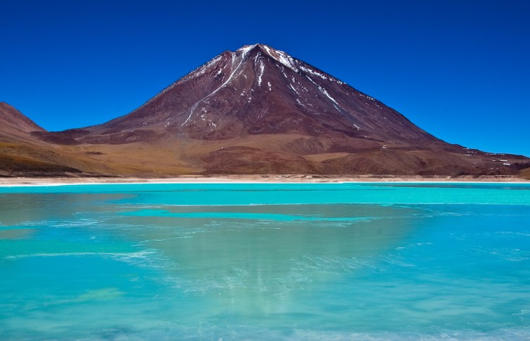 This is one of the most spectacular views that you will ever see. The Laguna Verde (Green Lagoon) is a salt lake in the southwest of the altiplano of Bolivia, on the Chilean border at the foot of the volcano Licancabur. Its colour is caused by sediments, containing copper minerals. It is elevated some 4,300 m (14,000 ft) above sea level.