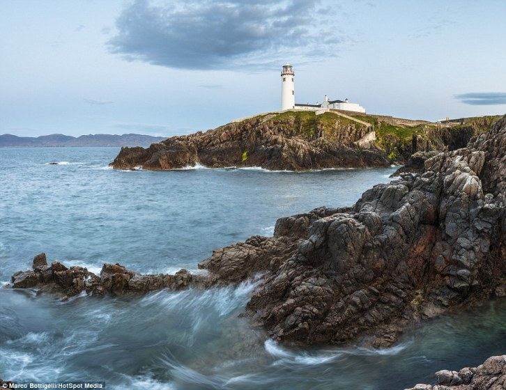 The long exposure on this picture gives the sea splashes against the rocks a magical quality at Fanad Head in County Donegal (above), Republic of Ireland
