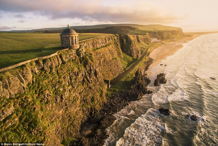 The scraggy rocks and soft rolling light proved inspiring to Bottigelli as he captured The Mussenden Temple in County Londonderry (above), Northern Ireland