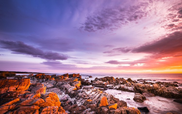 The Bay of Fires, on the northeastern coast of Tasmania in Australia, is a big bay that stretches for about 30 km from Binalong Bay in the south to Eddystone Point in the north.