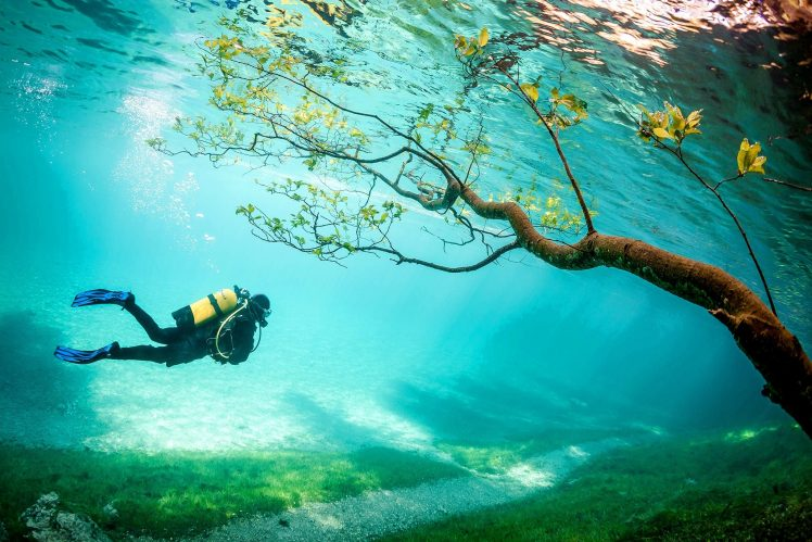 """Grüner See, is also called """"Green Lake"""", is a strange lake in Styria, Austria, near the town of Tragoss, located at the foot of the snow-capped Hochschwab Mountains."""