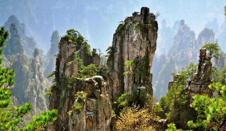 Zhangjiajie National Forest Park is a popular tourist destination, home to striking sandstone and quartz cliffs and famously known for renaming a peak after the mountain formations that inspired the fictional world of Pandora.