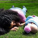 lying in a field, being a mom