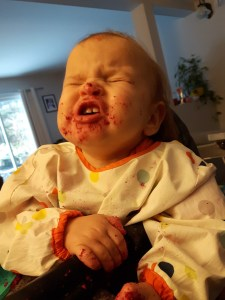 13 month old with food on her face