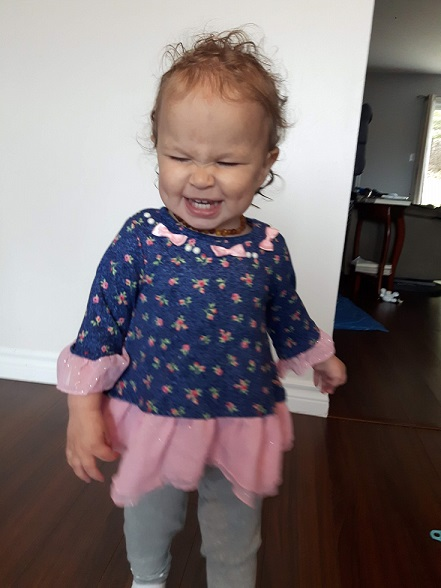 18 month old girl smiling