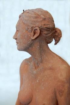 Sculpture, Woman seated on heels, head detail 2