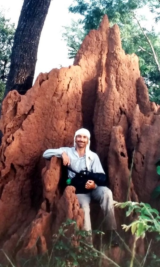 CLB sitting on a termite mound, Zimbabwe, EarthWatch.org expedition