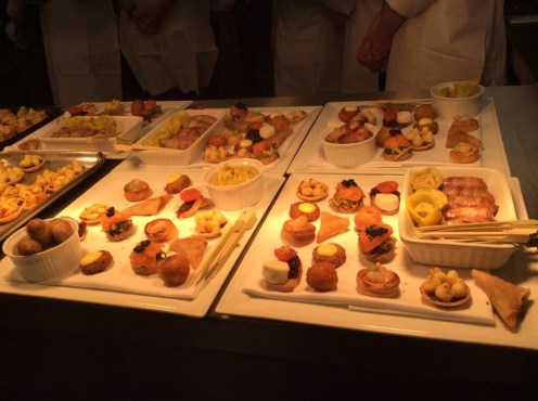 """Canapés included smoked salmon, curried cabbage and caviar, duck samosas, goats cheese and red onion jam, prawn Marie Rose pastries as well as """"pigs in blankets"""""""