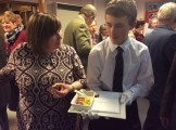 Miss Macpherson served canapés by Nathan Ross (S4).