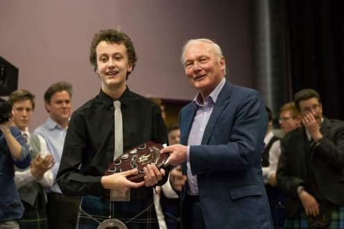 Euan Morrison receives the prize on behalf of the City of Inverness.