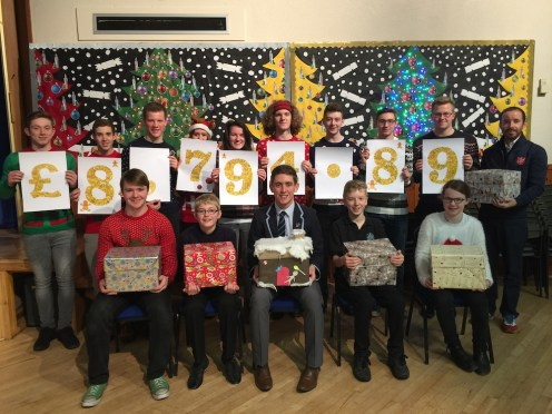 David Donaldson, far right, joins pupils demonstrating our fundraising total and hamper collection.