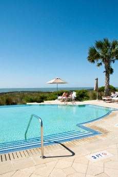 THE SANCTUARY POOL is where the best of two worlds collide: the panoramic view of the ocean paired with the comfort of umbrella-shaded chaises and cheerful servers who deliver fresh fruit smoothies to thirsty guests. Time, baked by the sun, slows down and the harried world seems far, far away.