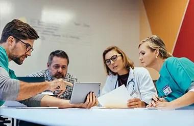 Team of healthcare workers having a meeting in boardroom.
