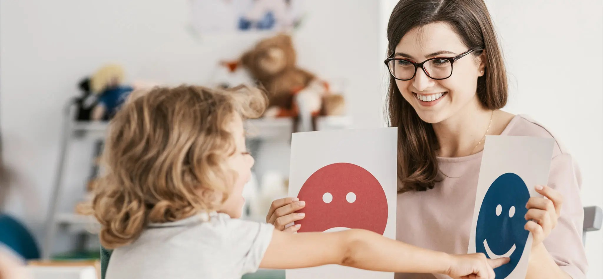 Emotion emoticons used by a psychologist during a therapy session with a child.