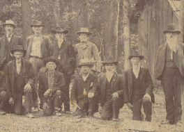 38th Alabama Infantry Volunteer Regiment CSA Reunion, Alabama, Circa 1900; George Washington Doggett is said to be the one standing 4th from left near center of photo; George Washington Doggett.jpg