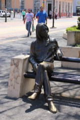 Sit on a park bench with John Lennon