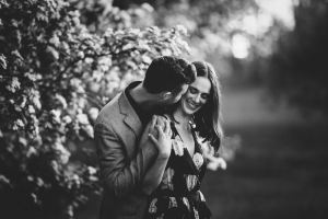 Ottawa Wedding Photographer shoots candid image of couple during engagement session at the Arboretum