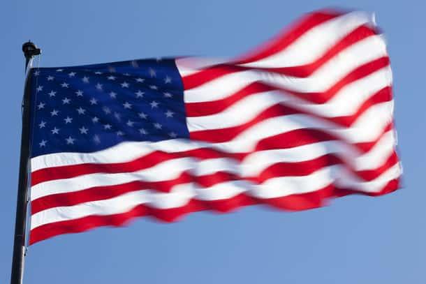The American Flag Against A Blue Sky
