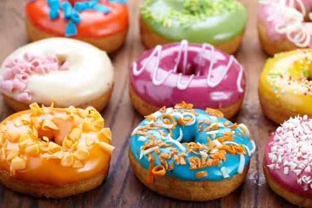 assortment of fresh baked donuts for national donut day