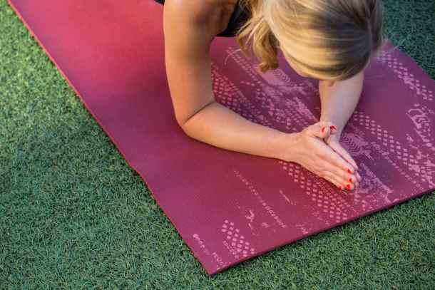 Woman practicing yoga outside