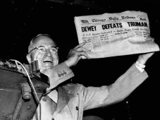 "Truman Waving ""Dewey Defeats Truman"" Headline"