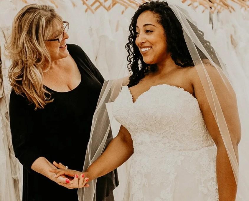 Stylist Celebrating Bride in her wedding dress