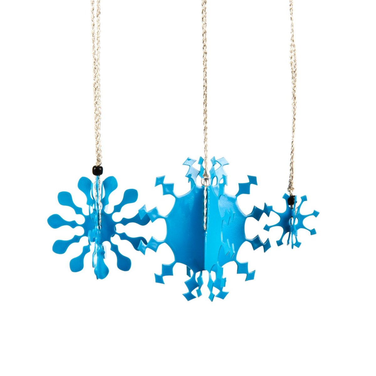 Three 3D metal snowflakes coated in blue enamel paint for hanging on the Christmas tree.