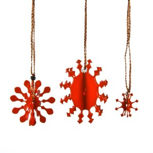 Three 3D metal snowflakes coated in red enamel paint for hanging on the Christmas tree.