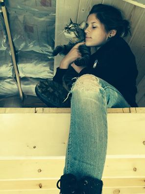 My Gorgeous Girl, with her kitty, in the tiny house she built.