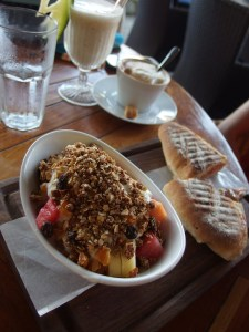 Toasted sandwich and yummy muesli with fruit and yoghurt