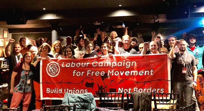 Labour Campaign for Free Movement activists pose with a huge banner