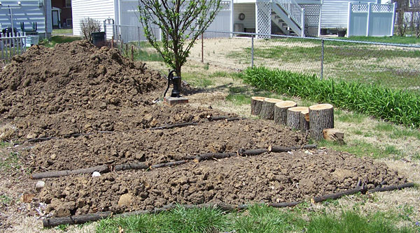 Adding dirt to raised beds