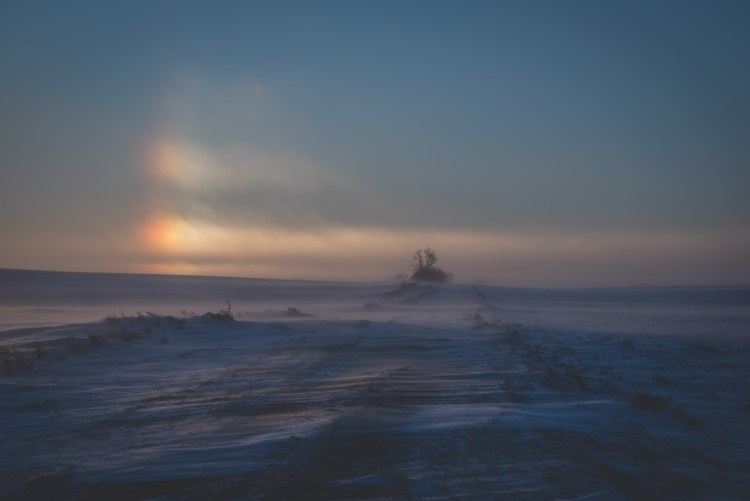 North Dakota's Winter Weather | North Dakota's winter weather is incredibly unique and unlike anywhere else I have been. | Chasing Departures | #winter #weather #sundogs #frozen #snow #northdakota #travel #photography