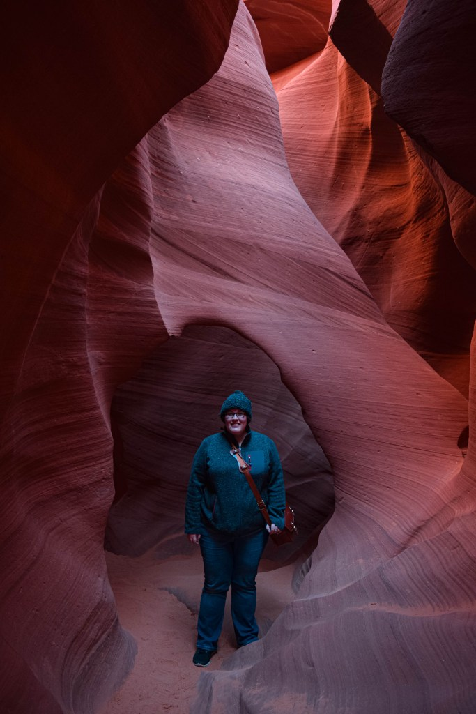 Me standing in a sandstone arch in Lower Antelope Canyon
