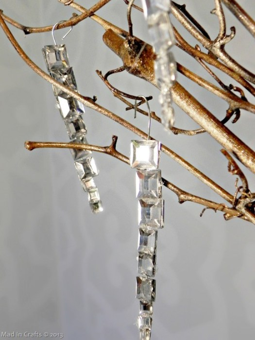 A string of faux gemstones hung to branches in order to look like icicles.
